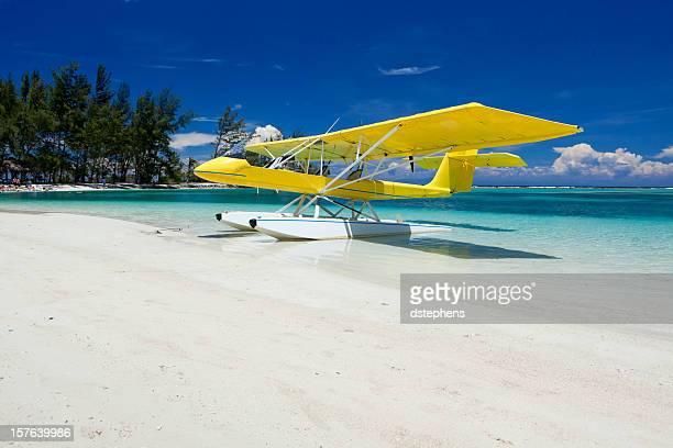 Yellow float plane on beach