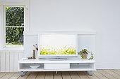 Yellow flowers on a liquid crystal TV.