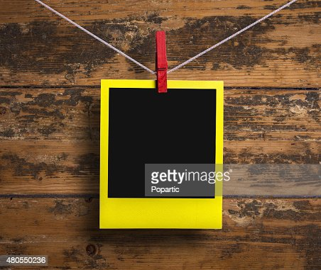 Yellow frame on a clothesline : Stock Photo
