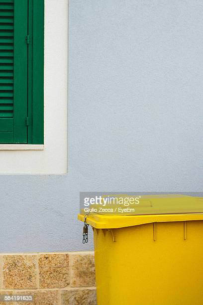 Yellow Garbage Can Outside House