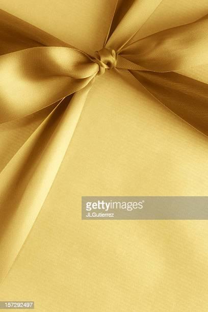 Yellow gift box with matching ribbon
