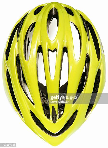 A yellow green cycling helmet