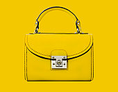 A yellow handbag against a yellow background