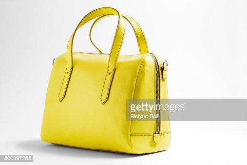 Yellow handbag on a white background