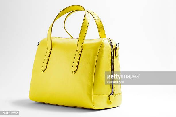 Yellow handbag on a white background