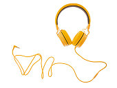 yellow headphones or earphone computer isolated on a white background.
