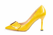 Yellow high heel shoes isolated on white background with clipping path. Women's shoes.
