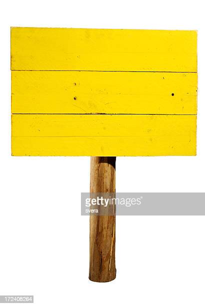 Yellow horizontal wooden sign on wood post isolated