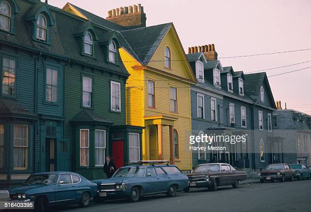 A yellow house on a street in St John's Newfoundland and Labrador Canada circa 1970