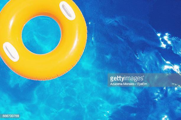 Yellow Inflatable Ring Floating At Swimming Pool