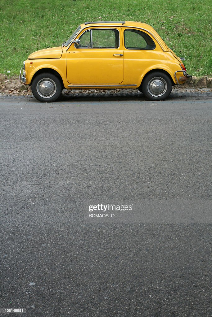 Yellow Italian vintage car in Rome : Stock Photo