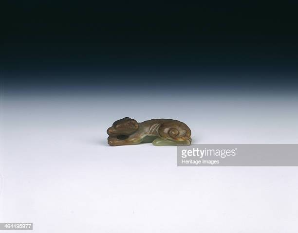 Yellow jade squatting greyhound Yuan dynasty China 12791368 A yellow jade squatting greyhound type dog The tail is neatly curled its head resting on...
