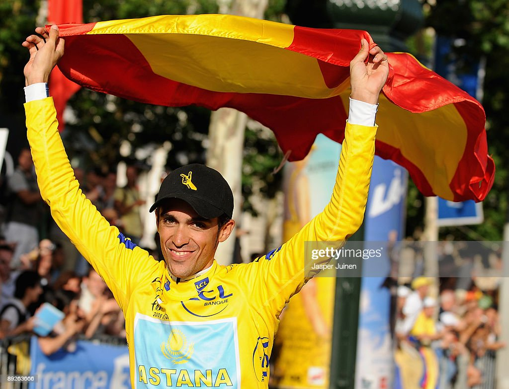 Yellow Jersey and race winner Alberto Contador of Spain and Astana celebrates with a spanish flag after Stage Twenty One of the Tour de France on July 26, 2009 in Paris, France.