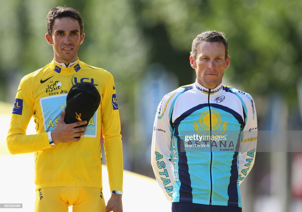 Yellow Jersey holder and race winner Alberto Contador (L) of Spain and Astana stands for the national anthems with third place Lance Armstrong of the USA and Astana after Stage Twenty One of the Tour de France on July 26, 2009 in Paris, France.