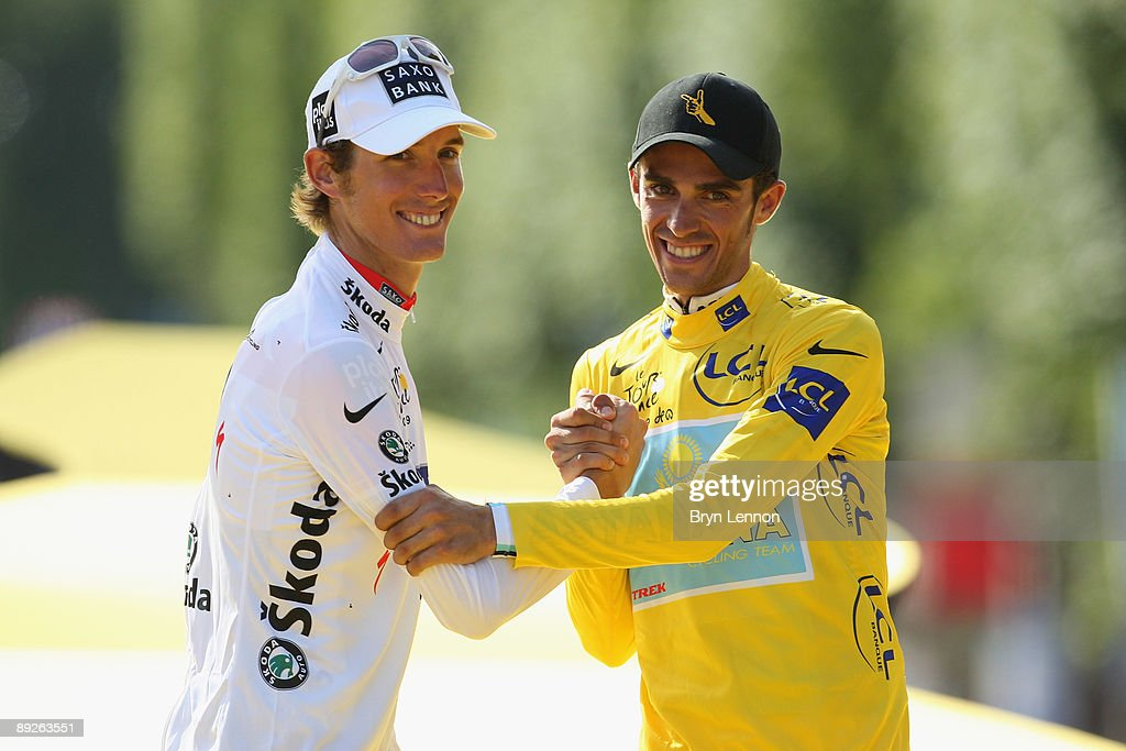 Yellow Jersey holder and race winner Alberto Contador (R) of Spain and Astana celebrates with second place Alex Schleck of Luxembourg and Saxo Bank after Stage Twenty One of the Tour de France on July 26, 2009 in Paris, France.