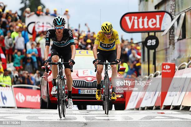 Yellow Jersey leader Chris Froome of Great Britain and Team Sky is helped to the finish line by team mate Wouter Poels at the end of the 146 km...