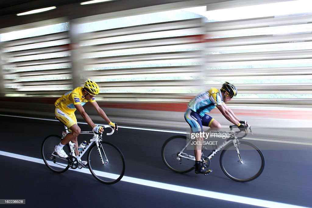 Yellow jersey of overall leader 2007 Tour de France winner and Kazakh cycling team Astana 's leader Alberto Contador of Spain rides with teammate...