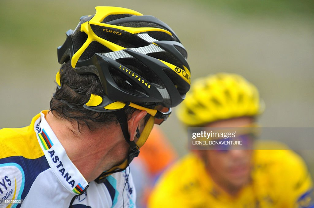 Yellow jersey of overall leader 2007 Tour de France winner and Kazakh cycling team Astana 's leader Alberto Contador of Spain is looked by teammate...