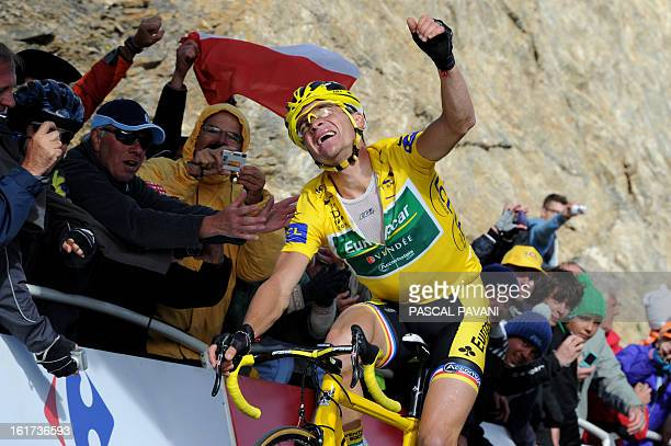 Yellow jersey of overall leader France's Thomas Voeckler is cheered by fans on the finish line at the end of the 2005 km and eighteenth stage of the...