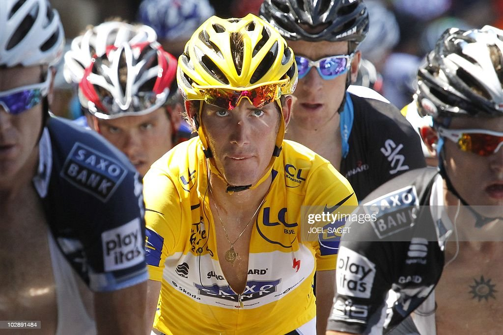 Yellow jersey of Overall leader, Luxembourg's Andy Schleck (C), rides on July 14, 2010 during the 179 km and 10th stage of the 2010 Tour de France cycling race run between Chambery and Gap, southeastern France.