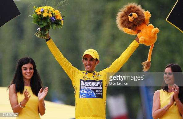 Yellow Jersey overall race winner Alberto Contador of Spain and Team Discovery Channel celebrates on the podium after Stage Twenty of the Tour de...