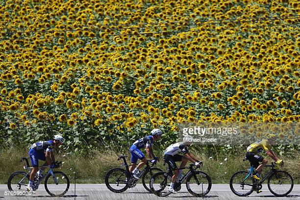 Yellow jersey race leader Chris Froome of Great Britain and Team Sky leads from Reinardt Janse van Rensburg of South Africa and Team Dimension Data...