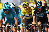 Yellow jersey race leader Chris Froome of Great Britain and Team Sky is guided over the finishing line by team mate Wouter Poels of Netherlands...