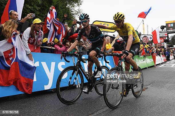 Yellow jersey race leader Chris Froome of Great Britain and Team Sky thanks team mate Wouter Poels of Netherlands after crossing the finishing line...