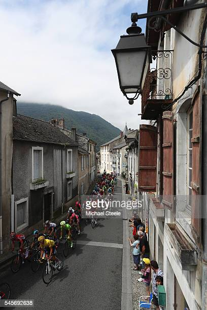 Yellow jersey race leader Greg van Avermaet of Belgium and BMC Racing team leads the peloton through the village of Saint Pe de Bigorre during the...