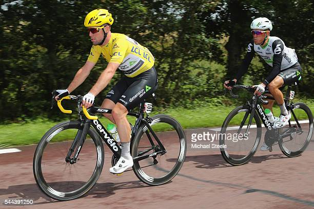 Yellow jersey race leader Mark Cavendish of Great Britain and Team Dimension Data is supported by Serge Pauwels of Belgium during stage two of Le...