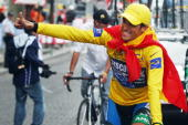 Yellow jersey Spain's Alberto Contador gives a thumbs up while riding in the honour lap after winning the 94th Tour de France cycling race after the...