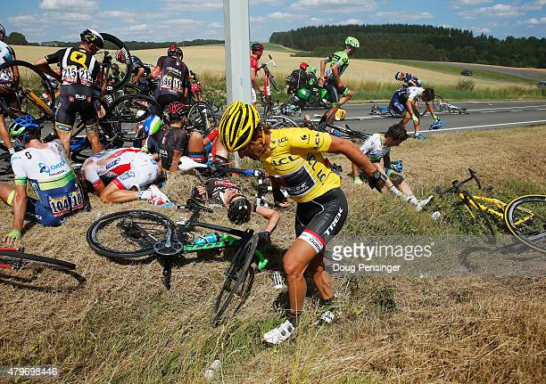 Yellow jersey wearer Fabian Cancellara of Switzerland and Trek Factory Racing gets to his feet following a crash near Brabant Wallon during stage...