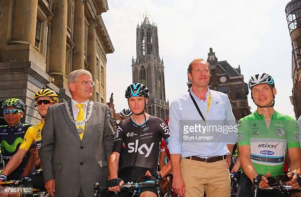 Yellow jersey wearer Rohan Dennis of Australia and BMC Racing Team Mayor Utrecht Jan van Zanen Chris Froome of Great Britain and Team Sky race...