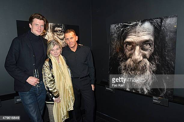 Yellow Korner galerie director Alexandre De Metz Isabelle Nanty and pPhotographer Lee Jeffries attend the Lee Jeffries Photo Exhibition Preview At...