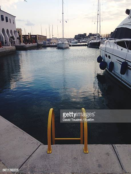 Yellow Ladder In Water In City Marina
