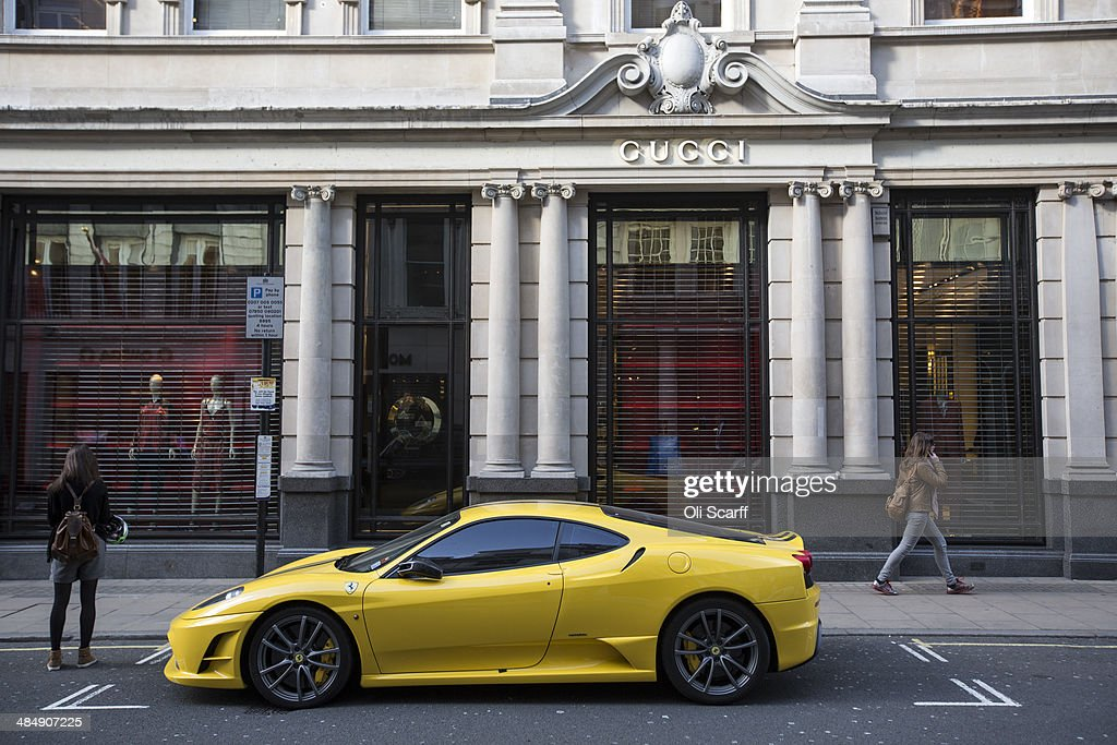 A yellow Lamborghini is parked outside Gucci on Old Bond Street on April 15 2014 in London England A report by property advisers Colliers...