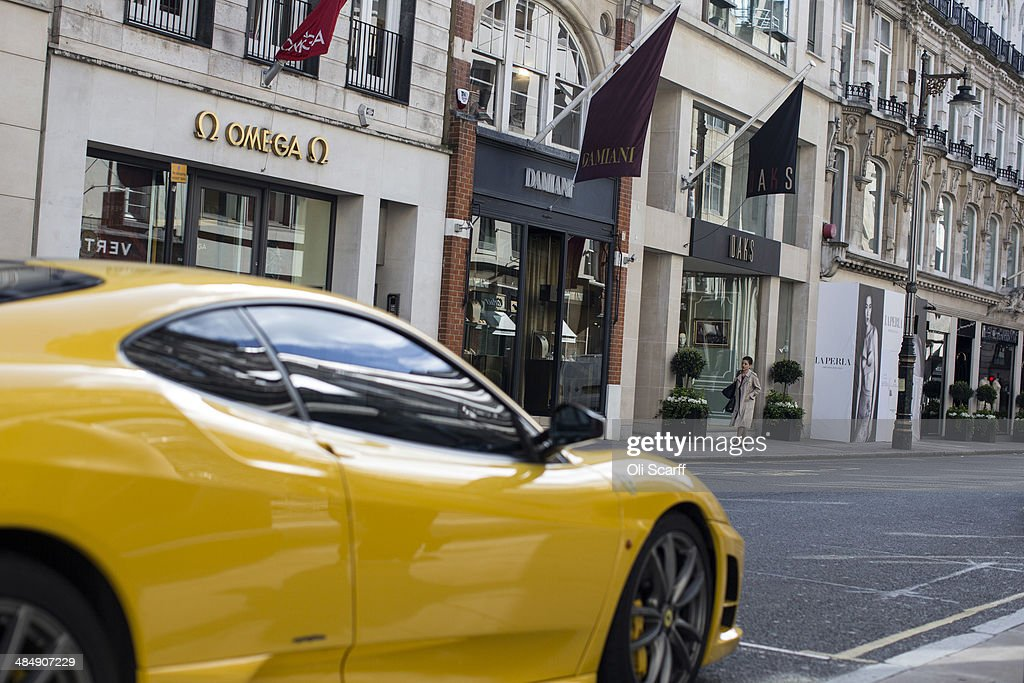 A yellow Lamborghini is parked outside luxury goods retailers on Old Bond Street on April 15 2014 in London England A report by property advisers...