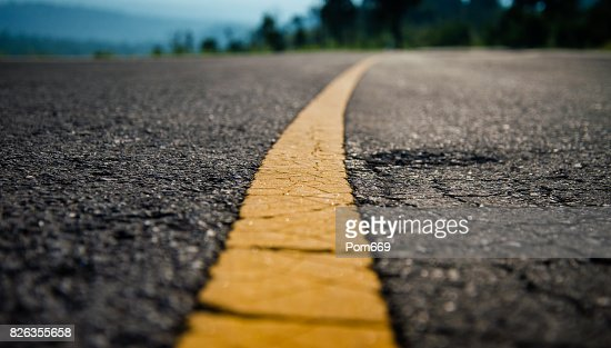 Yellow line on road : Stock Photo