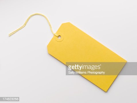 A yellow luggage tag on a white background