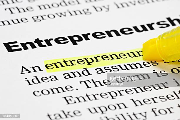 Yellow marker highlights 'entrepreneur' in a document