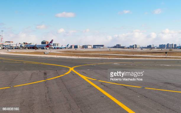 Yellow marking lines in Pearson International Airport taxiway-Toronto,Canada