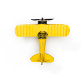 Yellow Metal toy plane isolated on white