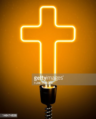 Yellow Neon tube lightbulb forming Religious Cross : Stock Photo