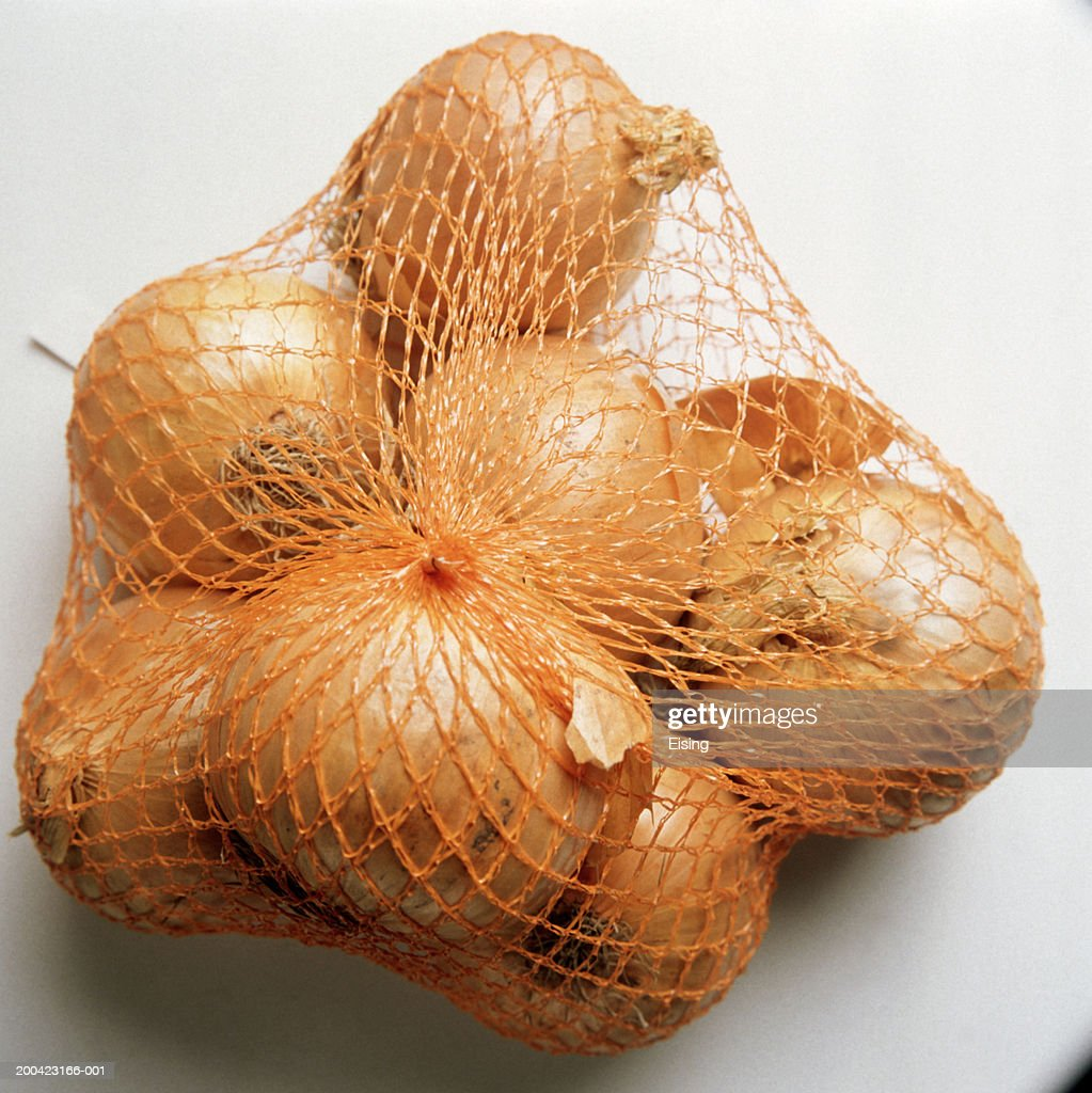Yellow Onions Hanging in a Net : Stock Photo