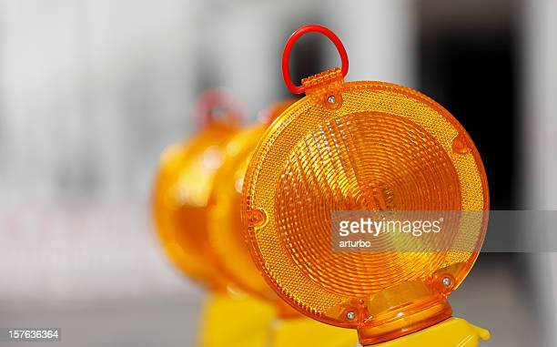 yellow orange traffic warning lamps