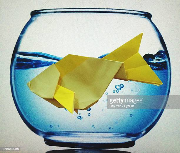 Yellow Origami Fish In Bowl Against White Background