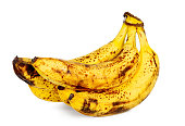 Isolated yellow over ripe bananas on white background