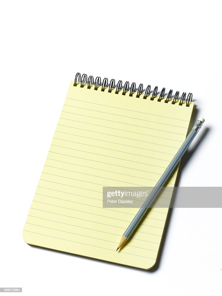 Yellow pad on white background. : Stock Photo