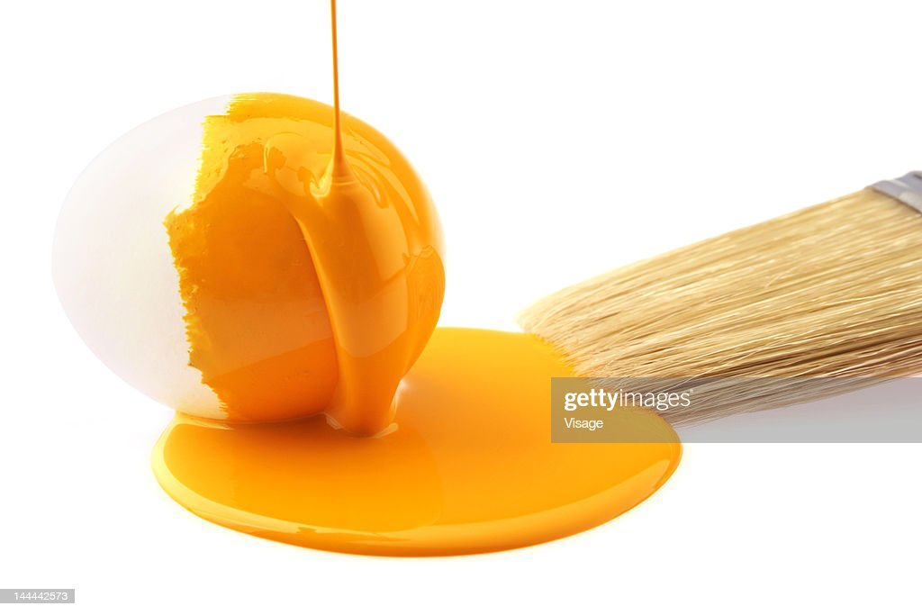 Yellow paint falling on an egg stock photo getty images for Eggshell yellow paint