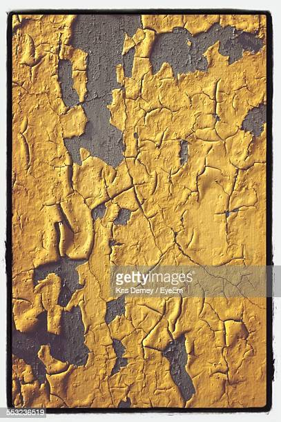 Yellow Paint Peeling From Wall